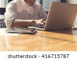 man's hand with laptop computer ...   Shutterstock . vector #416715787