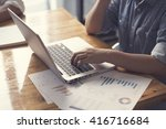 woman's hand with laptop... | Shutterstock . vector #416716684