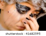 crying girl in spider makeup - stock photo
