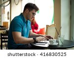 young businessman drinking...   Shutterstock . vector #416830525