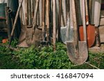 Farm Tools In Front Of A Wooden ...