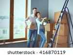 happy young couple unpacking or ... | Shutterstock . vector #416870119