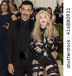 Small photo of New York City, USA - May 2, 2016: Riccardo Tisci and Madonna attend the Manus x Machina Fashion in an Age of Technology Costume Institute Gala at the Metropolitan Museum of Art