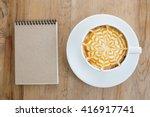 Hot Milk Art Coffee On Wooden...
