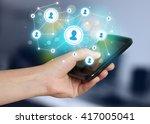 finger pointing on smartphone... | Shutterstock . vector #417005041