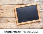 blackboard on wood old wall | Shutterstock . vector #417012061