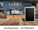 blank menu board on wooden top... | Shutterstock . vector #417066265