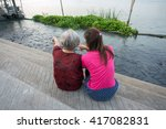 feeding the fish with love | Shutterstock . vector #417082831