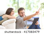 happy couple sitting and... | Shutterstock . vector #417083479