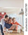 a modern family using a digital ... | Shutterstock . vector #417085789