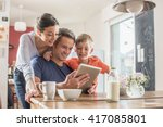 a modern family using a digital ... | Shutterstock . vector #417085801