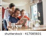 a modern family using a digital ... | Shutterstock . vector #417085831
