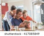 a modern family using a digital ...   Shutterstock . vector #417085849