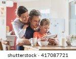 a modern family using a digital ... | Shutterstock . vector #417087721
