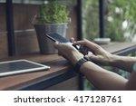 man's hand using smartphone...   Shutterstock . vector #417128761