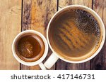 two cups of coffee on timber... | Shutterstock . vector #417146731