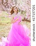 girl in a garden of peach's... | Shutterstock . vector #417157201