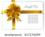 gold gift bow with ribbons.... | Shutterstock .eps vector #417176599