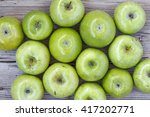 Green Ripe Apples On A Gray...