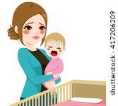 young tired sleepy mother... | Shutterstock .eps vector #417206209