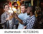 smiling man with a beer at a bar   Shutterstock . vector #417228241