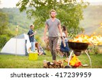 man put firewood in flared up... | Shutterstock . vector #417239959