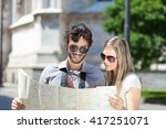 happy tourists couple holding a ... | Shutterstock . vector #417251071