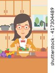 woman cooking vegetable salad. | Shutterstock .eps vector #417304489