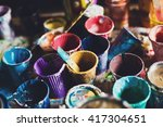 multicolored plastic cans with... | Shutterstock . vector #417304651