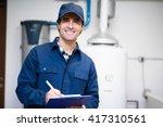 technician servicing an hot... | Shutterstock . vector #417310561