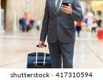 man walking in a train station... | Shutterstock . vector #417310594