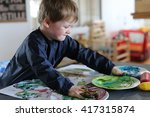young boy playing with... | Shutterstock . vector #417315874