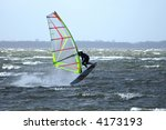 windsurfer performing an airjibe | Shutterstock . vector #4173193