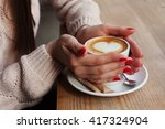 close up female hands holding... | Shutterstock . vector #417324904