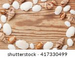 sea shells forming frame on the ... | Shutterstock . vector #417330499