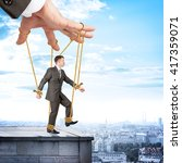 Image Of Businessman Hanging O...