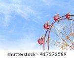 ferris wheel and blue sky  | Shutterstock . vector #417372589