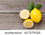 fresh ripe lemons on wooden... | Shutterstock . vector #417379105