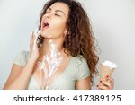 brunette sexually eats ice... | Shutterstock . vector #417389125