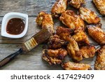 bbq chicken wings with sauce... | Shutterstock . vector #417429409