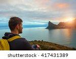 a tourist sits on a hill... | Shutterstock . vector #417431389