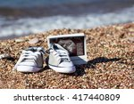 small baby boots at the sea and ... | Shutterstock . vector #417440809