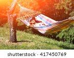 woman on hammock in spring... | Shutterstock . vector #417450769