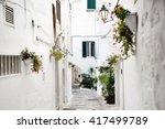 alley in white city ostuni ... | Shutterstock . vector #417499789