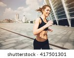 woman runner. running on city  | Shutterstock . vector #417501301