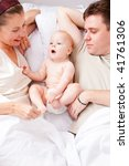 mom  dad and baby in bed | Shutterstock . vector #41761306