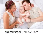 cheerful family lying in bed | Shutterstock . vector #41761309