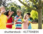 children running in the park on ... | Shutterstock . vector #417704854