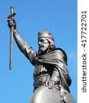 Small photo of King Alfred The Great's statue designed by Hamo Thornycroft and erected in 1899 stands at the eastern end of the Broadway in Winchester, Hampshire, England