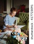 artist paints picture on canvas ... | Shutterstock . vector #417723091